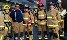 A group of firefighters from Whangaparaoa, near Auckland, prepare to tackle the Sky Tower climb.