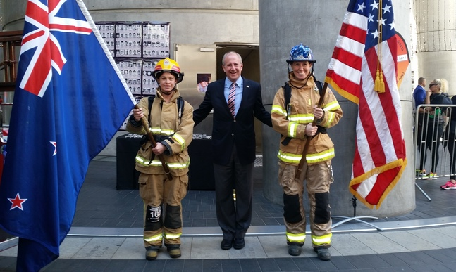 US Ambassador Mark Gilbert with flag bearers before the Sky Tower 9/11 memorial climb/