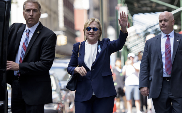 Hillary Clinton leaves her daughter's apartment building in New York where she rested after leaving a  9/11 memorial ceremony feeling unwell.