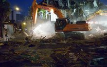 A digger demolishes part of the Carlton Hotel (Tim Graham)