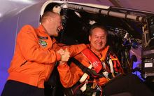 Bertrand Piccard (left) and Andre Borschberg before taking off in the Solar Impulse 2 from Abu Dhabi .