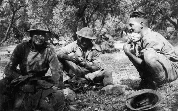 Soldiers shelter amongst olive trees on Crete.