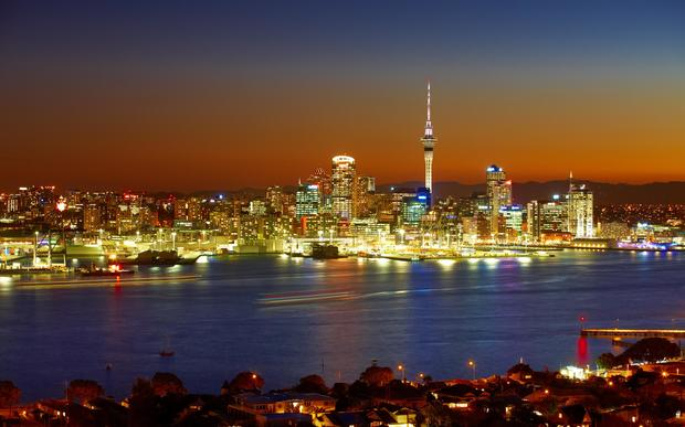 The Sky Tower and waterfront are lit by evening lights - as seen from Devonport on the North Shore.
