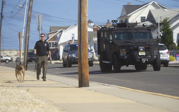 "Police patrol near the site of a ""pipe bomb-style device"" explosion along a running race route in New Jersey."