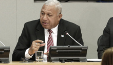 "Josaia Voreqe Bainimarama (left), Prime Minister of the Republic of Fiji, briefs journalists on the ""Implementation of the Paris Agreement - Consequences for the Humanitarian Summit and the 2030 Development Agenda"". Peter Thomson (right), Permanent Representative of Fiji to the UN."