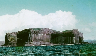 The Isle of Staffa, with its Fingal's Cave to the right - inspiration for Mendelssohn's Hebrides Overture.