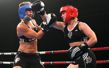 Snowboarder Hayley Holt takes on surfer Paige Hareb in a Fight For Life charity boxing event.