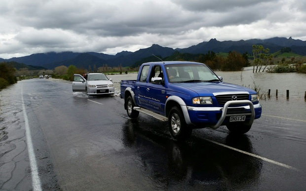 A car is towed after becoming caught in floodwaters on the way to Pauanui in the Coromandel.