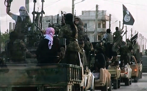 An image from an Islamic State video shows fighters entering Homs in 2014.