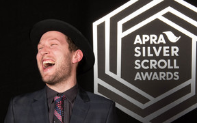 Thomas Oliver with his award, the 2016 Apra Silver Scroll.