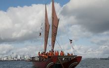 Waka Quest voyaging canoe Haunui sailing in the Waitemata Harbour.