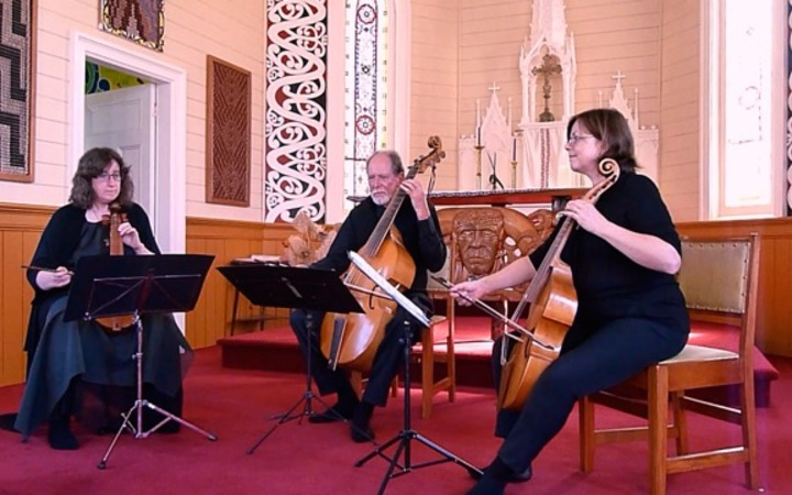 Robert Oliver (centre) and his group the Palliser Viols