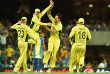 (From left) Australia's Michael Clarke, Steven Smith, Mitchell Johnson and Aaron Finch celebrate the wicket of India's Ravindra Jadeja during the 2015 Cricket World Cup semi-final match between Australia and India in Sydney on March 26, 2015.