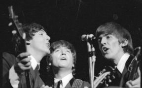 The Beatles - Paul McCartney, John Lennon and George Harrison singing during their 1964 Wellington Concert