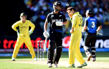 Grant Elliott makes his 50 in the final of the Cricket World Cup against Australia.