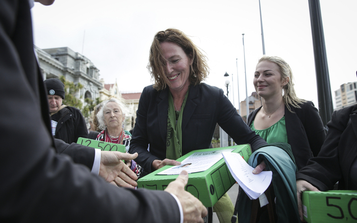 Members of Parliaments, lobists and supports gathered outside Parliament with petition to legalise cannabis, 17,000 people signed the petition. Rose Renton hands over the petitions