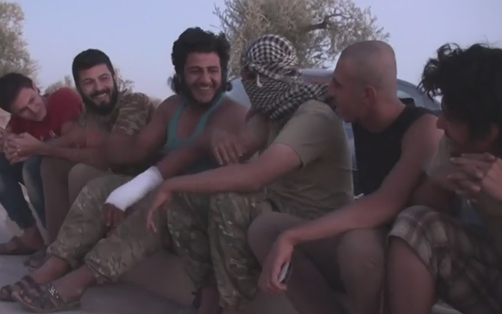 Men at the secret camp for Islamic State defectors in Syria.