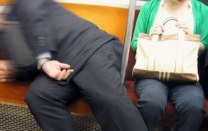 Now that's manspreading. Salaryman asleep on the Tokyo Subway