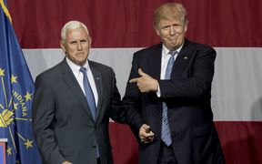 Republican presidential candidate Donald Trump greets Indiana Gov. Mike Pence at the Grand Park Events Center on July 12, 2016 in Westfield, IN.
