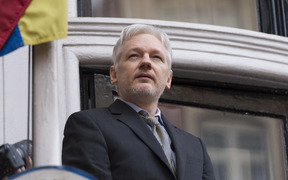 Julian Assange addresses media from the balcony of the Ecuadorian Embassy in London earlier this year