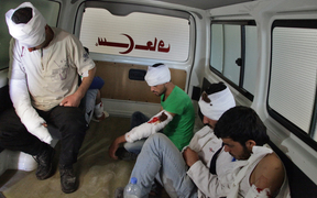 Wounded opposition fighters in an ambulance in Aleppo, as clashes erupted in an area designated as a humanitarian corridor for civilians to leave the embattled city, despite an announced pause in the Syrian army's Russian-backed offensive.