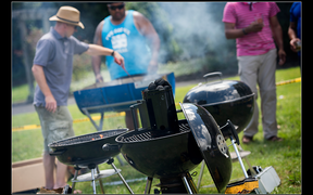 Photo of people BBQing at Braai Day