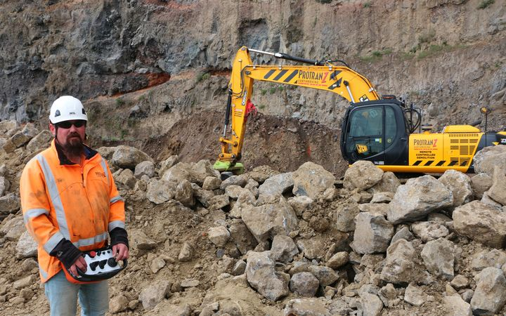 Vaughan Breen operates his digger by remote control at Dean's Head.