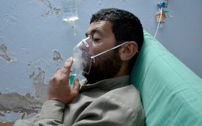 A Syrian man receives treatment at a field hospital following a suspected chlorine gas attack by Assad regime forces in Idlib, Syria on May 03, 2015.