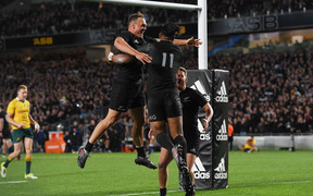 Julia Savea and teammates celebrate his try in the record-setting match against the Wallabies.