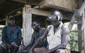 Former combatant and now cocoa farmer Timothy Koluvai experiences a VR film for the first time.