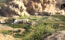 An image grab taken from a video made available by the Jihadist media outlet Welayat Nineveh showing explosives being detonated at the site.