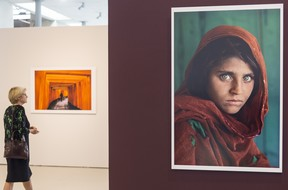 American photographer Steve McCurry's iconic photo 'Afghan Girl', taken of Sharbat Gula in 1985, is displayed at an exhibition in Turkey in 2015.