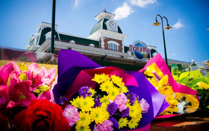 Flowers outside Dreamworld in Queensland, where four people died.