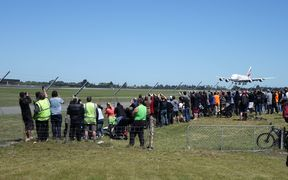 Hundreds of plane-spotters were at Christchurch Airport to watch the first scheduled arrival of the Airbus A380 at the airport.