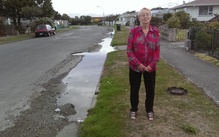 Joyce Fuller's street has had a constant flood of water ever since a spring came up in a neighbour's property in the earthquakes four years ago.