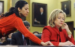 Hillary Clinton, right, receives a note from her aide Huma Abedin as she testifies during a in 2011.