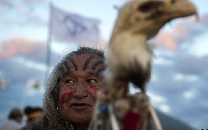 Phil Little Thunder Sr attends an evening gathering at an encampment where hundreds of people have gathered to join the Standing Rock Sioux Tribe's protest against the construction of the Dakota Access Pipeline.