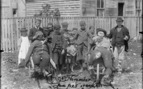 Children with rival guys, Guy Fawkes day at Ohingaiti. c1900