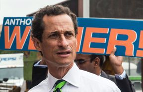 Anthony Weiner meets with people on a street corner In Harlem on September 10, 2013