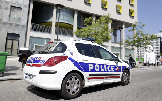A police vehicle parked outside a student residence in Paris on 22 April 2015.