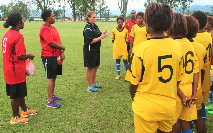 PNG Under 20 women's coach Lisa Cole instructs players at training.