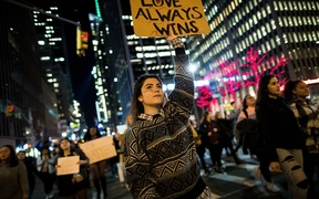 NEW YORK, NY - NOVEMBER 11: Anti-Donald Trump protesters march in the street on Fifth Avenue, November 11, 2016 in New York City. The election of Trump as president has sparked protests in cities across the country. Drew Angerer/Getty Images/AFP