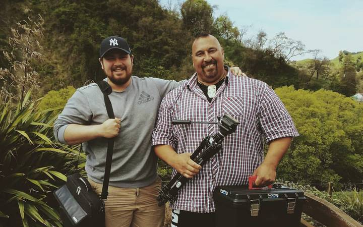 Filmmaker Jamie Dunn (left) spent ten weeks filming strongman Levi Vaoga (right).