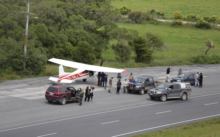 A Southland man flew to the area to check on friends and family, landing on State Highway 1.