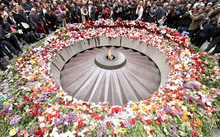 People lay flowers at the Tsitsernakaberd Memorial in Yerevan.