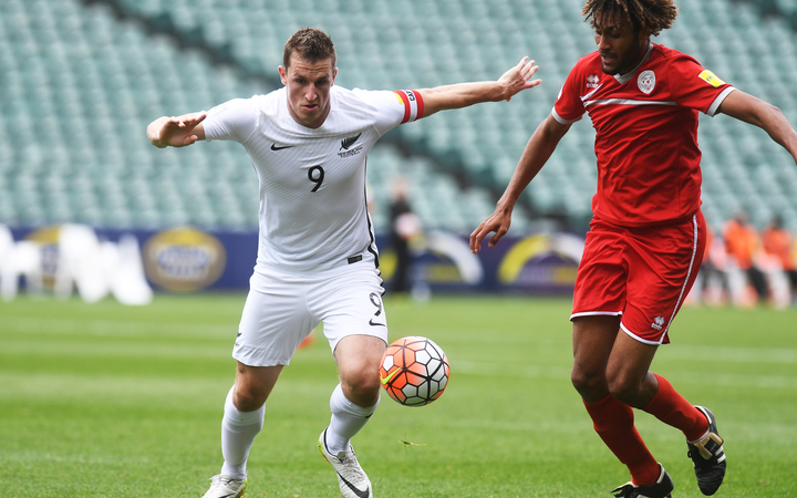 All Whites captain Chris Wood and New Caledonia's Cedric Sansot clash in Kone on 15 November 2016.