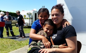 Koko Lambert with her daughter Tiara, 7, and son Elijah, 6, at the Ward emergency welfare centre.