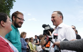 John Key talks to tourists waiting to leave