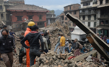 Rescue teams work to clear rubble in the capital's Durbar Square.
