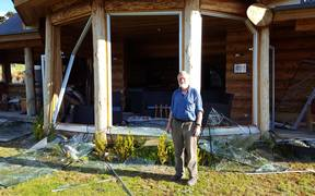 Don McIntosh in front of his condemned house in Mt Lyford.
